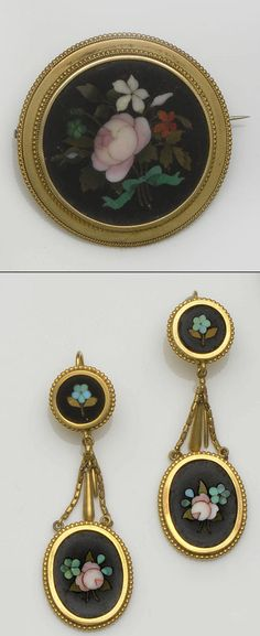 A pietra dura brooch and earpendants.  The brooch with circular pietra dura panel depicting a vari-coloured floral spray, bordered by ropetwist and beaded decoration, the earpendants of conforming design, each oval pietra dura panel drop below a double chain-link suspension and panel surmount, with beaded borders, brooch diameter 4.2cm, earpendants length 5.7cm.