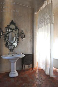 beauitufl bathroom with light through curtain