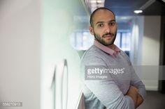 Foto de stock : Portrait serious businessman arms crossed in office corridor