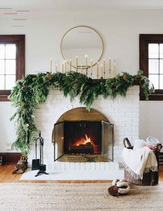 2018 Holiday Decor Asymmetrical garland: an unexpected take on traditional Holiday fireplace mantel decor. Hear my thought process and how to create the look at your house. Christmas Mantels, Christmas Home, Christmas Decorations, Christmas Pajamas, Natural Christmas, Christmas Wreaths, Christmas Ribbon, White Christmas, Christmas Sangria