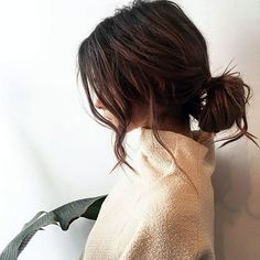 The Tousled Chignon - A perfect style to try the morning after a big event, messy, second-day waves look gorgeous tucked back into a low, insouciant bun. Pull a couple face-framing strands loose and wrap around the barrel of a curling iron to set the look and voilà—instant French-girl vibes.