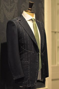 Bespoke suit from Savile Row. Prestigious tailors on the row often boldly display suits with stitches to show that they are a bespoke house.