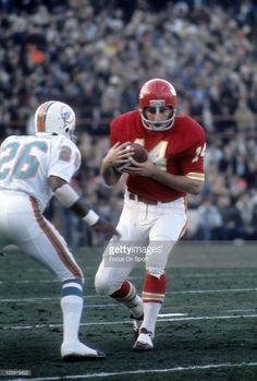Running Back Ed Podolak #14 of the Kansas City Chiefs running with the ball looks to get pass defensive back Lloyd Mumphord #26 of the Miami Dolphins during an NFL football game at Arrowhead Stadium in Kansas City, Missouri. Podolak played for the Chiefs from 1969-77.