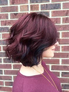 Wine purple red hair with oil slick bits towards the front. Love. Hair by Jessica @ Minerva's Hair Salon in MI.