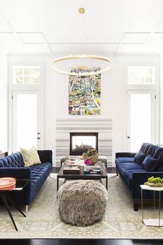 Ann Lowengart Interiors Modern Living Room in Norcal blue velvet sofas and quartz lined chandelier