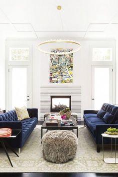 Ann Lowengart Interiors Modern Living Room // blue velvet sofas and quartz-lined chandelier