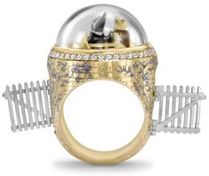 """Mole & Toad"" Wind in the Willows-inspired ring by Theo Fennell. Two tiny figures converse atop a golden bridge underneath a removable rock crystal dome.  The bridge is adorned with silver willow branches. Click through for more images."