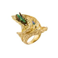 Ilgiz Fazulzyanov's Wind in the wheatfield ring. This incredibly detailed ring, entitled Wind in the Wheat Field, is so lifelike it looks like the enamel grasshopper might leap off at any moment. Nestled amongst a golden sheaf, in the centre you will find the hidden treasure: a 1.77 carat black opal. Elements of nature are evident in many of Ilgiz F's one-off designs, including hovering dragonflies, iridescent insects, golden wheat and even a snail. | via thejewelleryeditor.com