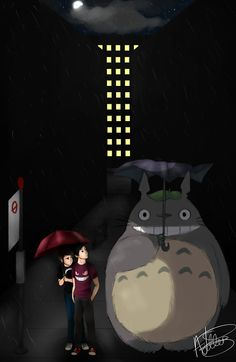 Dan, Phil, and Totoro. I'd imagine that they would both be all over that thing, but still this picture is adorable :D