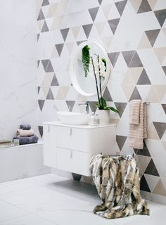 A feature wall in the bathroom is an excellent way to create interest in the space. Use geometric cut decor tiles to define different areas like behind the bathroom vanity. Layer in colour to the look with plush towels, plants and beautiful coloured vases or candles. #featurewall #geometrictiles #tiles #decortile #home #homedecor #trendingdesign #homegoals #trendyhome Colored Vases, Geometric Tiles, Feature Walls, Trendy Home, Design Trends, Towels, Floors, Plush, Vanity