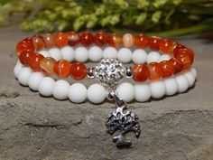 About the Bracelet Fun and lively orange and white bracelet made with quality gemstones and a sparkling Pave bead with a Bodhi Tree Charm. Bracelet Details: This beautiful bracelet is made with: - 6mm