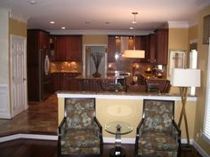 Benjamin Moore Golden Tan - love this with dark cabinets. Feels very warm and cozy!