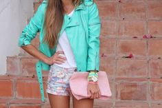 mint leather jacket and floral shorts.