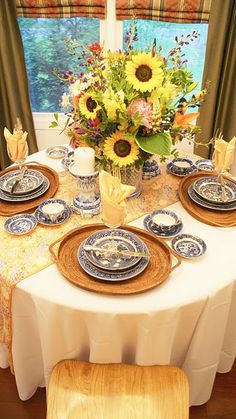 Sunflowers.....kind of fallish....blue and yellow tablescape