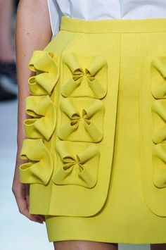 Playful details of an overlay on a yellow skirt. Fabric Manipulation (Del Pozo SS 2015)