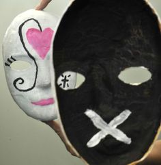 A mask made by a woman in a domestic violence support group shows, in the reflection at left, what the victim shows the world. The inside of the mask, right, represents what the victim is really going through. Photographed at the Women's Center of Greater Danbury on Thursday, May 3, 2012. Photo: Jason Rearick / The News-Times