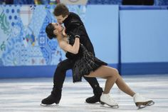 Elena Ilinykh, bottom, and Nikita Katsalapov, from Russia, perform their free dance in the ice dance portion of the team figure skating even...