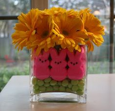 Easter arrangement - uses a vase filled with jelly beans, easter peeps and pretty flowers.