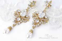 These crystal bridal earrings feature a stunning art deco chandelier design. Beautiful wedding earrings are created with lovely rhodium finish,