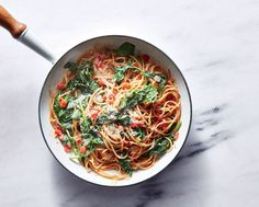 One-Pot Pasta with Spinach and Tomatoes | What could be easier than pasta for dinner? Cooking the pasta right in the sauce, saving time and cleanup and infusing the noodles with more flavor. The pasta is also endlessly adaptable, thanks to a short list of ingredients that are likely already in your pantry. Change up the spinach for any vegetables you have on hand (such as sliced zucchini and mushrooms), or add leftover diced cooked chicken thighs or cooked and crumbled sausage.