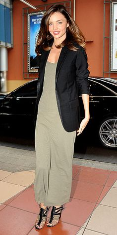 Kerr topped a sleek khaki jumpsuit with a chic black blazer and color-coordinated strappy sandals.