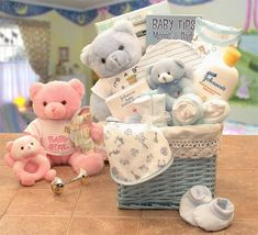"""""""Sweet Baby of Mine New Baby Basket = The Sweet Baby of Mine New Baby Basket is a fabric lined storage hamper filled with baby items, and it's available in pink for girls or blue for boys. This gorgeous teddy bear delivers your good wishes along with cute little clothing items, tiny toys, and a baby picture frame. All of your friends will love to receive the Sweet Baby of Mine New Baby Basket when their babies arrive!"""