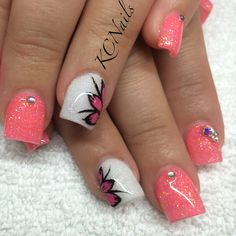 Coal peach acrylic nails with white accent and hand painted pink flower. Swarovski crystal accents   KCNails
