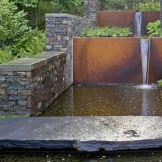 steel walls and water | Corten steel and stone walls create a cascading water feature.