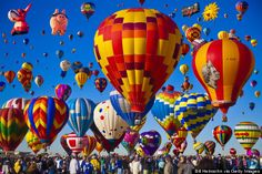 The Albuquerque International Balloon Fiesta It's not abnormal for over 100,000 people to turn up at the world's biggest hot air balloon festival, when hundreds of hot air balloons hit the big blue sky at once. As they light up for a Balloon Glow night ascent, you feel all magical and ticklish inside.