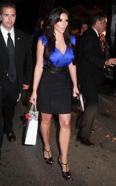 Kim Kardashian Pencil Skirt - Kim wore a blue silk blouse with a body-skimming…