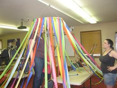 DIY Circus Tent Look starts with a hula-hoop and several roles of crepe paper. DIY Circus Tent Look