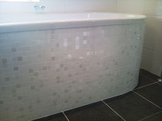 Mozaic tiles crafted to wrap arund the Lagaro bath