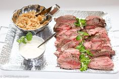My Easy Go to Beef Tenderloin Recipe along with an easy horseradish sauce and caramelized onions! Love this easy yet delicious combination for dinner parties and holidays. Don't forget to garnish the platter!