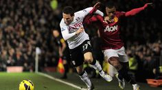 Sascha Riether of Fulham and Nani of Manchester United tussle for the ball during the Barclays Premier League match between Fulham and Manchester United at Craven Cottage on February 2, 2013 in London, England