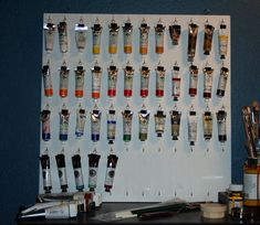 Storing tubes of paint using binder clips & hooks.  Can be done on the inside of a cabinet door.