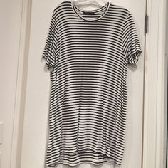 Brandy Melville t shirt dress Very comfy and versatile. Worn once but has a makeup stain on the sleeve. It should be able to be washed out but I'm not positive. Brandy Melville Dresses