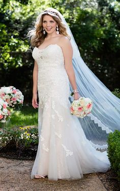 6257+ Lace Appliques Plus Size Wedding Dress by Stella York. Find this dress at Janene's Bridal Boutique located in Alameda, Ca. Contact us at (510)217-8076 or email us info@janenesbridal.com for more information.