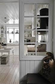 He east reuse of an old French door, division between the kitchen and dining space.