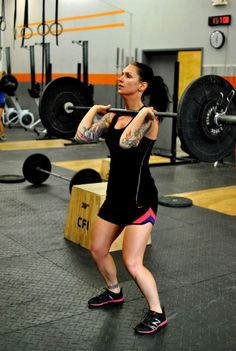 Just as in the clean, we now have another opportunity to take advantage of the springiness of the bar in order to complete the lift. Here's how you do it.