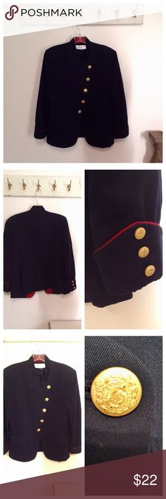 Jones New York Wool Military Style Blazer Jacket Beautiful Military Style Wool Coat  Long Sleeves Buttons at a diagonal Military Style metal etched buttons Wool Lined Navy blue with red piping trim Buttons at cuffs too  Good condition.   Best suited for size 10 medium  38 bust 34 waist  Remember this fine over a top or blouse.  I accept offers too. Jones New York Jackets & Coats Blazers