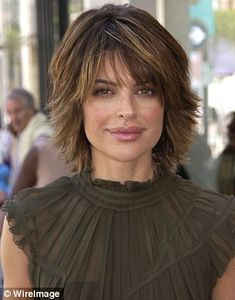 Up top: Women who use injections to plump their top lip larger than their bottom lip, like Real Housewives' Lisa Rinna, are said to be prone to causing drama in their relationships