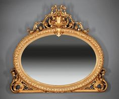 A fine American Rococo Carved Giltwood Overmantel Mirror : mid-19th century (=)