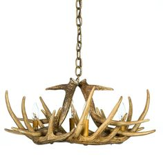 The Whitetail Deer 6 Antler Chandelier is very compact to create special lighting in small spaces. This antler chandelier is a great choice for a filler for smaller areas that need that special highlight. It is only has four 25-watt candle lights and weighs approximately 8 pounds. When looking for a way to light those small, deep corners, this chandelier is the perfect choice.