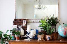 love the styling of this vignette, plants mingled in with lovely, little tidbits ~ photo from by Rubyellen of Cakies blog featured on A Beautiful Mess blog