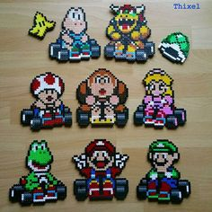 Mario Kart perler beads by thixel Reminder for birthday-party favors. Perler Bead Designs, Perler Bead Templates, Diy Perler Beads, Pearler Bead Patterns, Perler Patterns, Pearler Beads, Hama Art, Perler Bead Mario, Pokemon