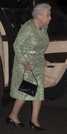 Queen Elizabeth II stepped out for a private dinner n Bellamy's in Mayfair. The Queen opted for a touch of glitz for the occasion, wearing a green sequinned dress and a triple string of pearls.