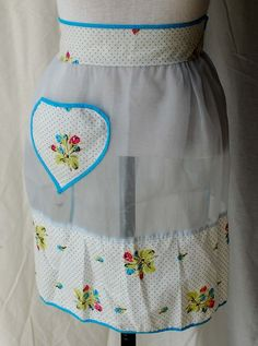 Women's 1950s blue sheer with fabric with dots and flowers apron