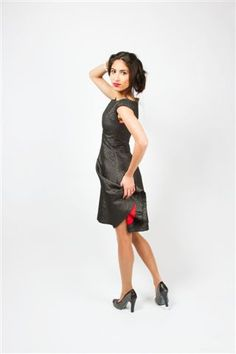 A- line party dress with boat neck. We custom make each dress to fit your curves perfectly. Prices start at 295 Euro's.