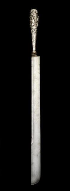 A Sumatran Sword (sikin) with Burmese silver hilt. Indonesia and Burma, 19th Century
