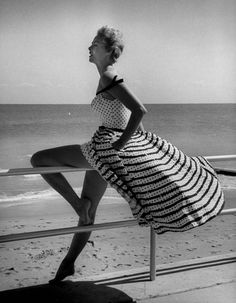 by Nina Leen - 1955 Miami | seaside | vintage | stripes | 1950's | beach | sun | sand | surf | summer love | wind in the hair | striped | vintage | black & white photography | elegance
